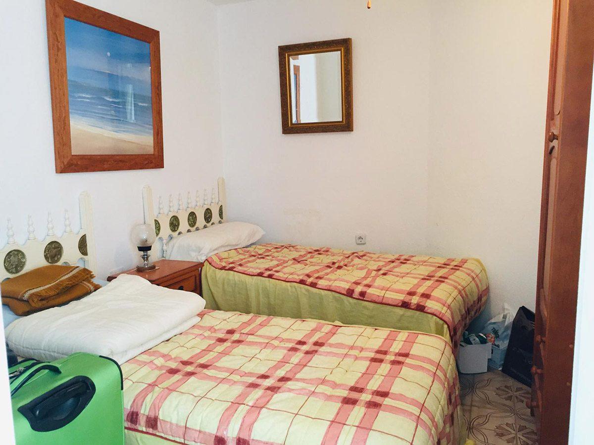 Уютная квартира с видом на океан в Los Silos кровати в спальне